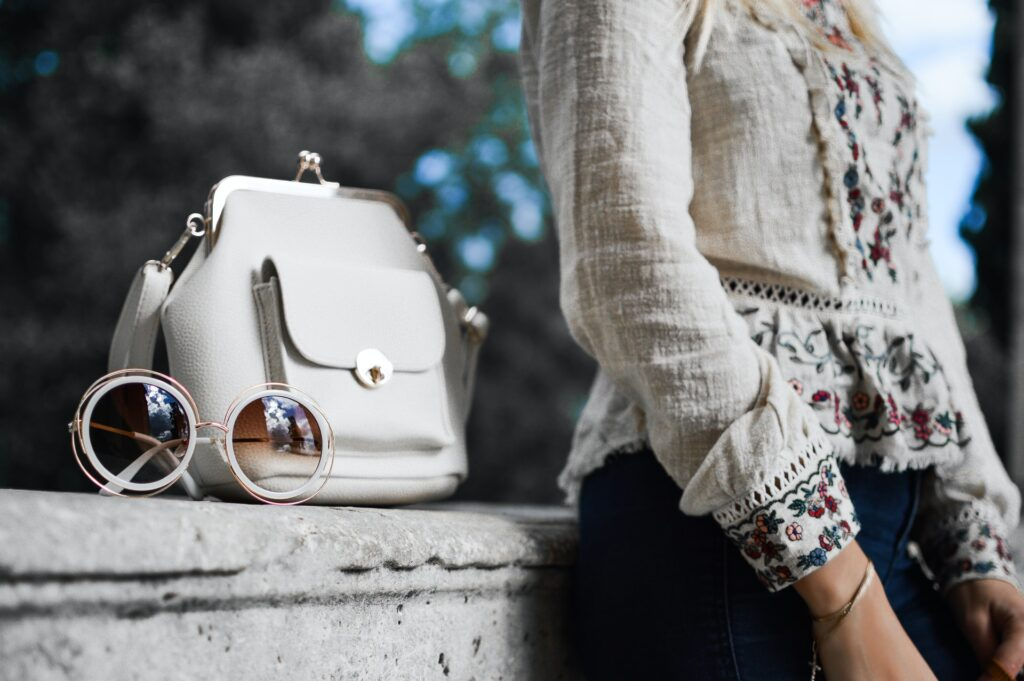 Picture of a purse next to model.